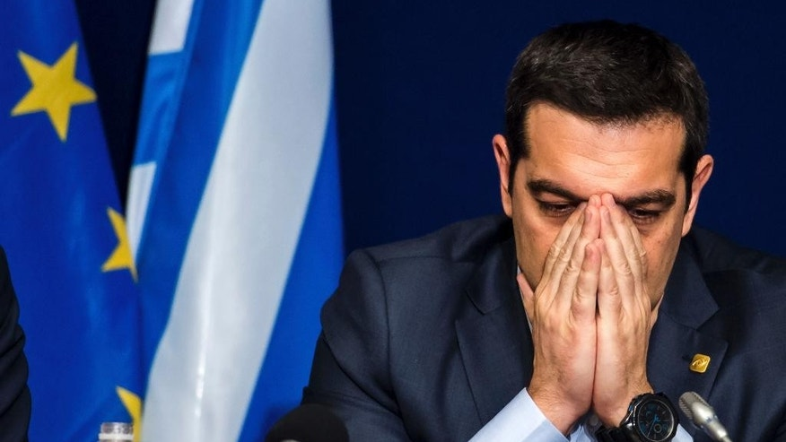 Greek Prime Minister Alexis Tsipras pauses before answering questions during a media conference after an EU summit in Brussels on Thursday, Feb. 12, 2015. European Union leaders on Thursday said the full respect of the planned weekend cease-fire in eastern Ukraine will be essential before there could be a change in the sanctions regime imposed on Moscow. (AP Photo/Geert Vanden Wijngaert)