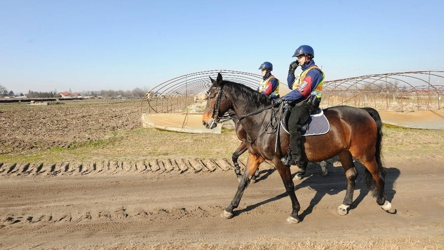 Mounted police officers patrol in the vicinity of Morahalom, 179 kms southeast of Budapest, Hungary, next to the Serbian border, Friday, Feb. 13, 2015. More than thirty officers of the special unit of the Hungarian police have been deployed in this border area. In the last few months, tens of thousands of mostly Kosovo Albanians seeking a better life in the EU have flooded across Serbia into EU member Hungary. The migrants also have included many Syrians, Afghans, Iraqis and others. (AP Photo/MTI, Zoltan Gergely Kelemen)
