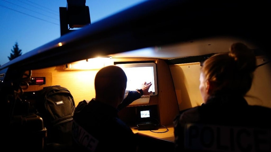 Members of the German border police check a security camera display as they monitor a stretch of the Serbian border with Hungary in the village of Hajdukovo, some 180 kilometers north of Belgrade, Serbia, Friday, Feb. 13, 2015. Some 20 German police officers, equipped with vehicles with thermal vision cameras, joined Serbian security forces on Serbia's border with Hungary on Friday to try to halt a torrent of migrants that has alarmed many European Union countries. (AP Photo/Darko Vojinovic)