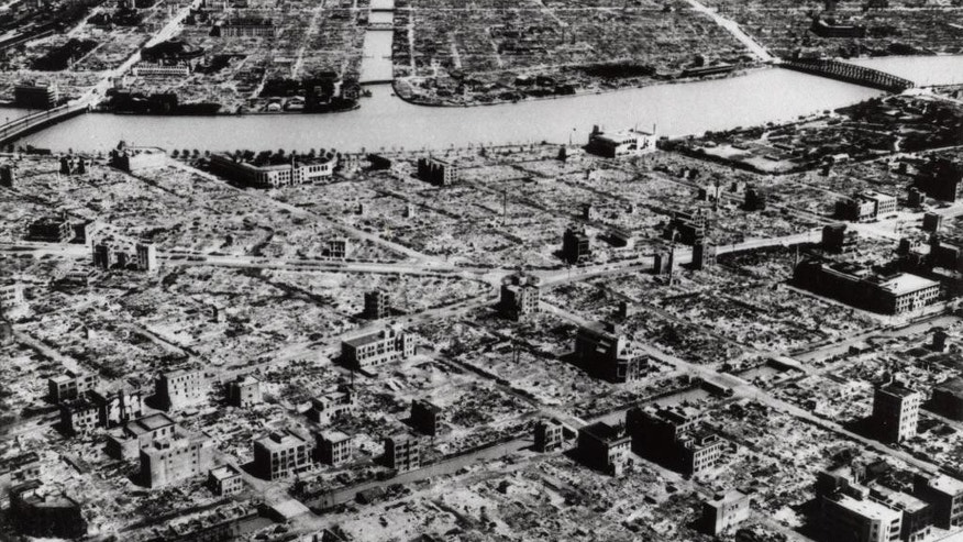FILE - This aerial photo taken in March 9, 1945 shows the industrial section of Tokyo along the Sumida River. The nuclear bombs dropped by the United States on Hiroshima and Nagasaki in August 1945 killed about 130,000 people, secured Japan's surrender and ended World War II. Less well-known, perhaps, is Operation Meetinghouse - the firebombing of Tokyo five months earlier. (AP Photo, File)