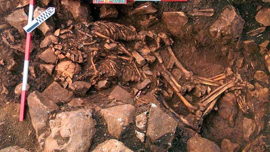 In this undated handout photo released by the Greek Culture Ministry on Friday, Feb. 13, 2015 shows the remains of a man and woman in their early twenties, buried as they died nearly 6,000 years ago - locked in a tight embrace in Diros, southern Greece. Such double burials are very uncommon, and this is the oldest of its kind in Greece, archaeologist Anastassia Papathanassiou told the Associated Press Friday. The discovery was made in 2013, but announced this week - just before Valentine's Day. (AP Photo/Greek Culture Ministry)