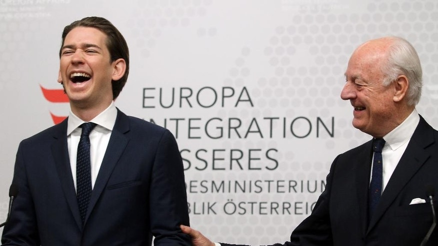 Austrian Foreign Minister Sebastian Kurz and UN Special Envoy for Syria Staffan de Mistura, from left, informs the press after talks at the foreign ministry in Vienna, Austria, Friday, Feb. 13, 2015. (AP Photo/Ronald Zak)