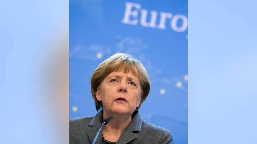 German Chancellor Angela Merkel speaks during a media conference at the end of an EU summit in Brussels on Thursday, Feb. 12, 2015. European Union leaders on Thursday said the full respect of the planned weekend cease-fire in eastern Ukraine will be essential before there could be a change in the sanctions regime imposed on Moscow. (AP Photo/Virginia Mayo)