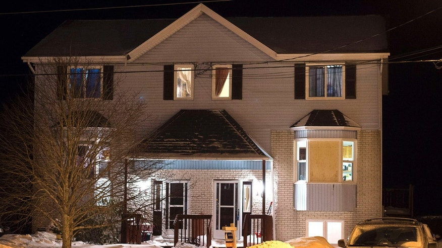 Feb. 13, 2015: A car is parked outside a home on Tiger Maple Drive in Timberlea, Nova Scotia, a Halifax suburb, where police found a deceased person