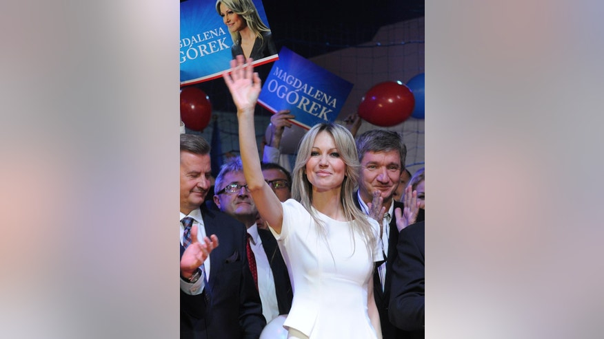 Poland's leading left-wing candidate for president Magdalena Ogorek greets supporters during her electoral convention in Ozarow Mazowiecki, Poland, Saturday, Feb. 14, 2015. Ogorek criticized Poland's current leadership for its strong critical stance toward Russia and suggested it bears some blame for the deep tensions between the two neighbors. The presidential election will be held May 10. (AP Photo/Alik Keplicz)