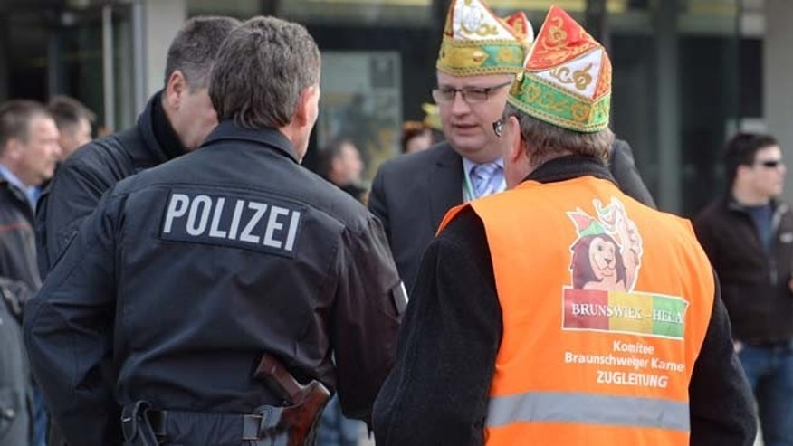 Feb. 15, 2015: Carnival parade organizers and police discuss in Braunschweig, Germany. (AP)