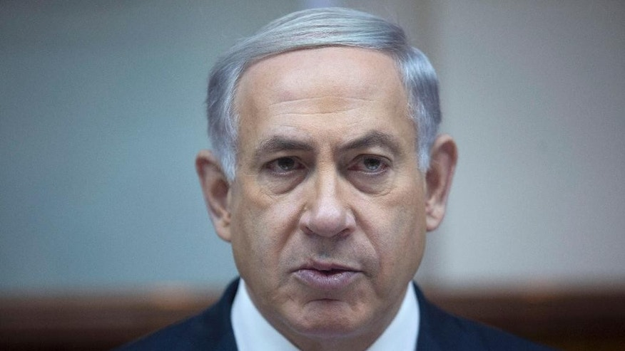 Israel's Prime Minister Benjamin Netanyahu chairs the weekly cabinet meeting in Jerusalem, Sunday, Feb. 15, 2015. (AP Photo/Abir Sultan)