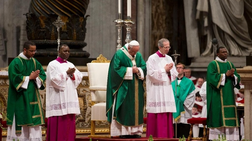 Pope Francis celebrates a Mass for newly-elected cardinals, in St. Peter's Basilica at the Vatican, Sunday, Feb. 15, 2015. Pope Francis welcomed 20 new cardinals Saturday into the elite club of churchmen who will elect his successor and immediately delivered a tough-love message to them, telling them to put aside their pride, jealousy and self-interests and instead exercise perfect charity. (AP Photo/Andrew Medichini)