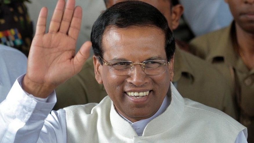 "FILE - In this Jan. 9, 2015 file photo, Sri Lanka's then-incoming President Maithripala Sirisena waves to supporters as he leaves the election secretariat in Colombo, Sri Lanka. Sri Lanka's new president was due to arrive in New Delhi on Sunday, Feb. 15 for his first trip abroad, underlining India's importance as a regional ally after years of increasingly uneasy relations. Indian officials will welcome Sirisena with a ceremony Monday, a banquet and two days of top-tier meetings befitting the countries' ""unique"" historical and cultural ties, Indian foreign ministry spokesman Syed Akbaruddin said. (AP Photo/Eranga Jayawardena, File)"
