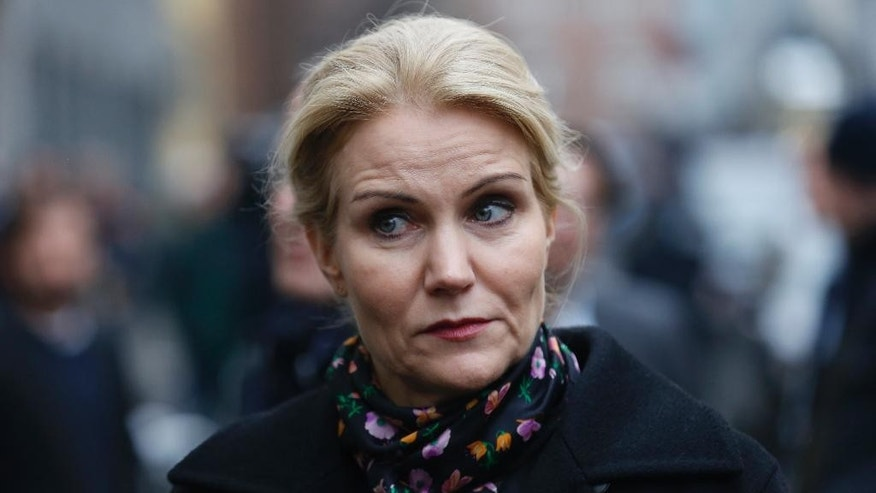 Dansh Prime Minister Helle Thorning-Schmidt pays respects Sunday Feb. 15, 2015, at the Copenhagen Synagogue for the victims for the Saturday night's shootings in Copenhagen.  Danish police shot and killed a man early Sunday suspected of carrying out shooting attacks at a free speech event and then at a Copenhagen synagogue, killing two men, including a member of Denmark's Jewish community. Five police officers were also wounded in the attacks. (AP Photo / Thomas Borberg, Polfoto) DENMARK OUT