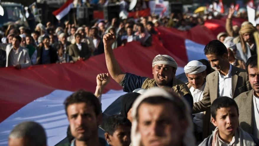 Feb. 11, 2015: Supporters of Houthi Shiites shout slogans while marching on a street as they celebrate the fourth anniversary of the uprising in Sanaa, Yemen. (AP)