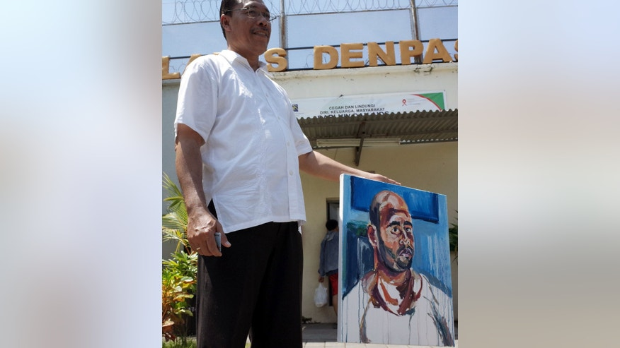 Tuesday, Feb. 10 2015: Pastor Ketut Waspada shows a painting by Myuran Sukumaran, after his visit to Sukumaran and Andrew Chan in a prison in Bali, Indonesia.