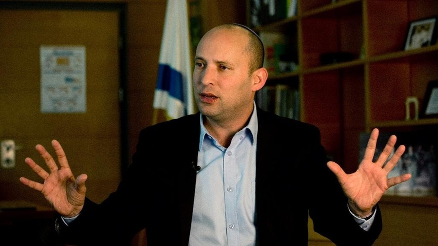 Naftali Bennett, leader of the Jewish Home party, speaks during an interview to the Associated Press in Jerusalem, Monday, Feb. 16, 2015. With Benjamin Netanyahu under fire internationally for his hardline policies, a key partner of Israeli prime minister is standing firmly behind him ahead of the March parliamentary elections heralding what could be an even tougher stance toward the Palestinians if they sit together in the next government. (AP Photo/Tsafrir Abayov)