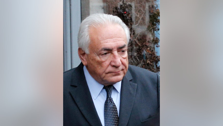 Feb. 11, 2015: Former International Monetary Fund boss Dominique Strauss-Kahn leaves his hotel in Lille, northern France, as he goes on trial for sex charges at a court. (AP)
