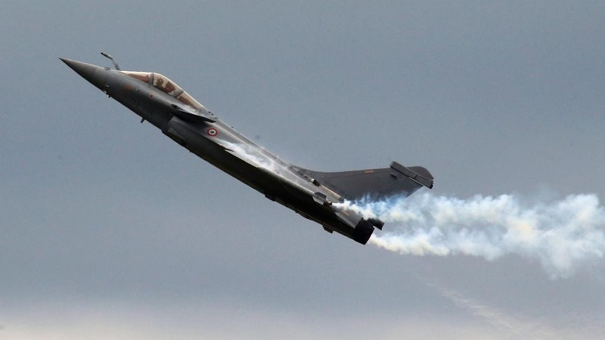 FILE - This Friday, June 21, 2013 file photo shows a French Air Force Rafale fighter performing its demonstration flight during the 50th Paris Air Show at Le Bourget airport, north of Paris, France. Egypt will become the first foreign buyer of Rafale fighter jets, French officials said Thursday, purchasing 24 of the multi-role French-made aircraft as part of a 5.2 billion-euro (US$5.93 billion) defense deal that will strengthen Cairo's military might in a tense and violent region. (AP Photo/Francois Mori, File)