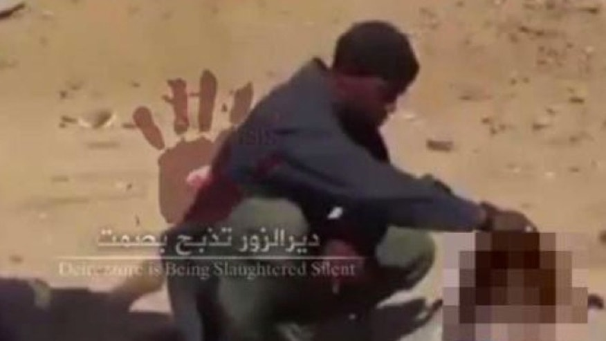 In this screengrab from a video believed to have been shot in November, Cuspert holds the severed head of a victim of ISIS (Raqqa is Being Slaughtered Silently)