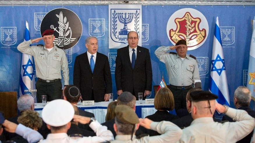 Israeli Prime Minister Benjamin Netanyahu, second from left, stands with Israel's Defense Minister Moshe Yaalon, second right, new Israeli Chief of Staff Gadi Eizenkot, right and  Lt. Gen. Benny Gantz, during a ceremony at the Prime Minister's office in Jerusalem, Monday, Feb. 16, 2015. (AP Photo/Sebastian Scheiner)