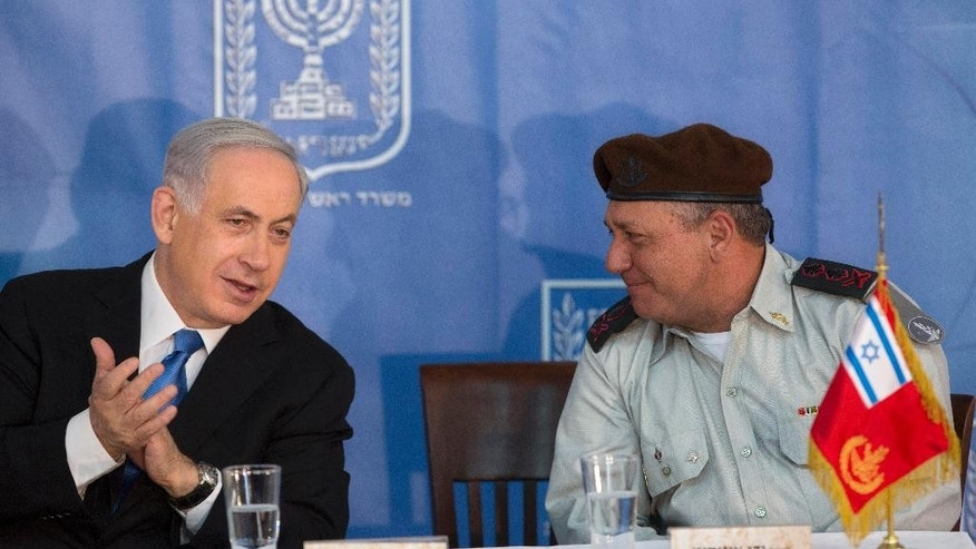 Israeli Prime Minister Benjamin Netanyahu, left, speaks with new Israeli Chief of Staff Gadi Eizenkot during a ceremony at the Prime Minister's office in Jerusalem, Monday, Feb. 16, 2015. (AP Photo/Sebastian Scheiner)