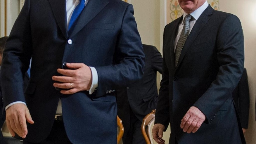 """FILE - In this Tuesday, Jan. 14, 2014, file photo, Russian President Vladimir Putin, right, and Hungarian Prime Minister Viktor Orban walk during their meeting in the Novo-Ogaryovo residence outside Moscow. Russian President Vladimir Putin travels to Budapest on Tuesday Feb. 17, 2015 to meet  Viktor Orban, the leader some Hungarians cast as his alter ego  """"Little Putin."""" (AP Photo/RIA-Novosti, Sergei Guneyev, Presidential Press Service, File)"""