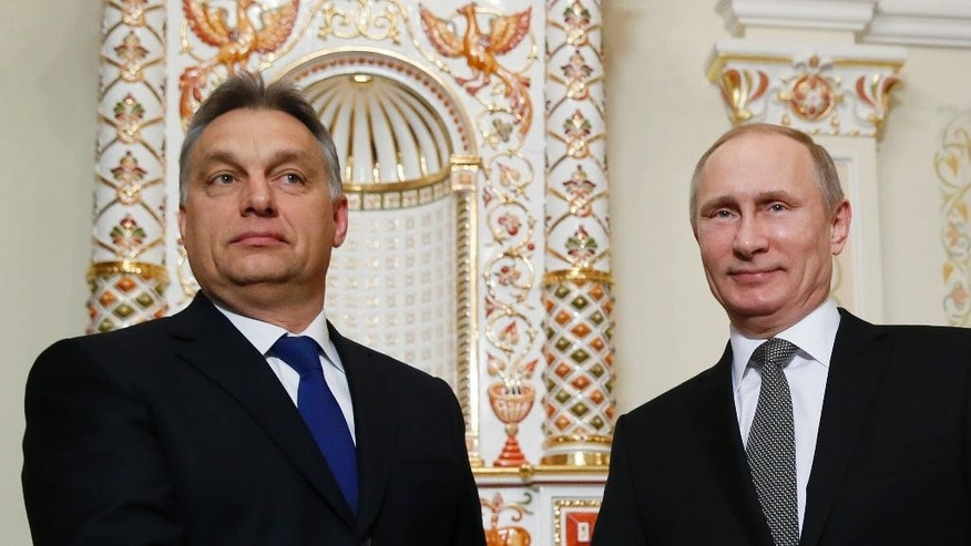 """FILE - This is a Tuesday, Jan. 14, 2014  file photo of Russian President Vladimir Putin, right, and Hungarian Prime Minister Viktor Orban  as they meet in the Novo-Ogaryovo residence outside Moscow, Russia. Russian President Vladimir Putin travels to Budapest on Tuesday Feb. 17, 2015 to meet  Viktor Orban, the leader some Hungarians cast as his alter ego  """"Little Putin."""" (AP Photo/Yuri Kochetkov, Pool. File)"""