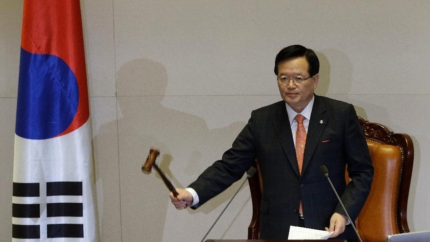 South Korean National Assembly Speaker Chung Ui-hwa bangs the gavel as he announces passing a confirmation of President Park Geun-hye's nomination of Lee Wan Koo as the country's prime minister during the plenary session at the National Assembly in Seoul, South Korea, Monday, Feb. 16, 2015. South Korea's ruling party-controlled legislature on Monday approved Park's choice for prime minister following fierce political wrangling over whether he's fit for the country's No. 2 job. (AP Photo/Ahn Young-joon)