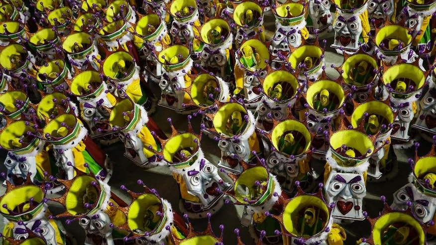 Performers from the Academicos do Grande Rio samba school parade during carnival celebrations at the Sambadrome in Rio de Janeiro, Brazil, Sunday, Feb. 15, 2015. (AP Photo/Felipe Dana)