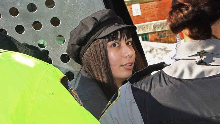 Lindsay Souvannarath arrives at provincial court in Halifax, Nova Scotia, on Tuesday, Feb. 17, 2015. Souvannarath and Randall Steven Shepherd, of Halifax, are charged with conspiracy to commit murder, allegedly plotting a Valentine's Day mass shooting at the Halifax Shopping Centre. (AP Photo/The Canadian Press, Tim Krochak)