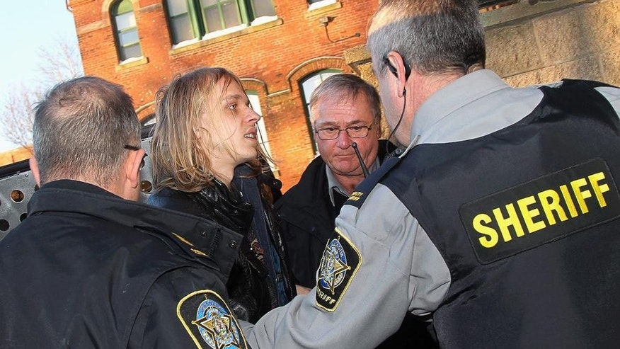 Randall Steven Shepherd arrives at provincial court in Halifax, Nova Scotia, on Tuesday, Feb. 17, 2015. Shepherd and American Lindsay Souvannarath are charged with conspiracy to commit murder, allegedly plotting a Valentine's Day mass shooting at the Halifax Shopping Centre. (AP Photo/The Canadian Press, Tim Krochak)