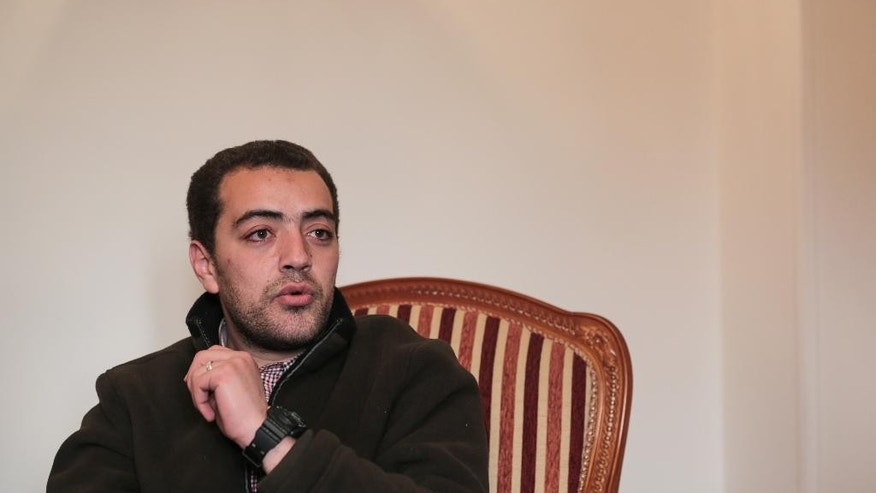 Al-Jazeera English journalist Baher Mohammed, who was recently released from prison along with two colleagues, speaks during an interview with the Associated Press at his home in 6 October city, a suburb southwest of Cairo, Egypt, Tuesday, Feb. 17, 2015. Mohammed, one of three Al-Jazeera English journalists released after over a year in Egyptian prison says he is optimistic he would be exonerated from terrorism-related charges during his retrial which begins next week. (AP Photo/Mosa'ab Elshamy)