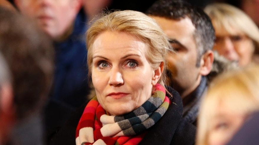 Danish Prime Minister Helle Thorning-Schmidt takes part in a vigil near the cultural club in Copenhagen, Denmark, Monday, Feb. 16, 2015. The slain gunman behind two deadly shooting attacks in Copenhagen was released from jail just two weeks ago and might have become radicalized there last summer, a source close to the Danish terror investigation told The Associated Press on Monday. (AP Photo/Michael Probst)