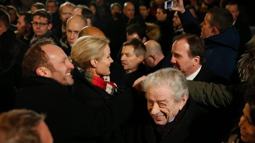 Danish Foreign Minister Martin Lidegaard, left, Prime Minister Helle Thorning-Schmidt, second left, Swedish Prime Minister Stefan Lofven, right, and former Danish Rabbi, Bent Melchior, bottom right, talk during a vigil in honor of the two men killed  by a gunman over the weekend, at Oesterbro, near the Teater Building 'Krudttonden', the scene of the first attack, Monday, Feb. 16, 2015 in Copenhagen Denmark. (AP Photo/Polfoto, Finn Frandsen) DENMARK OUT
