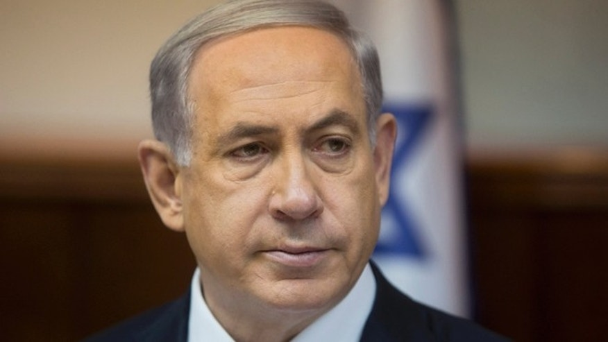 Feb. 8, 2015: Israeli Prime Minister Benjamin Netanyahu attends the weekly cabinet meeting in his Jerusalem office.