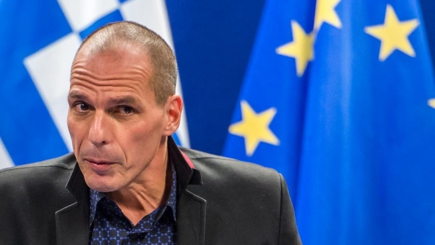 Greece's Finance Minister Yanis Varoufakis addresses the media after a meeting of Eurogroup finance ministers at the EU Council building in Brussels on Monday, Feb. 16, 2015. Greece's radical left government and its European creditors headed into new talks Monday on the debt-heavy country's stuttering bailout program, but expectations are low despite a fast-approaching deadline for some kind of deal. (AP Photo/Geert Vanden Wijngaert)