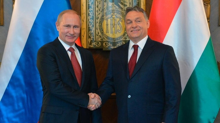 Russian President Vladimir Putin, left, and Hungarian Prime Minister Viktor Orban shake hands during their meeting at the parliament building in Budapest, Hungary, Tuesday, Feb. 17, 2015. Putin is on a one-day working visit in the Hungarian capital. (AP Photo/RIA Novosti, Alexei Druzhinin, Presidential Press Service)