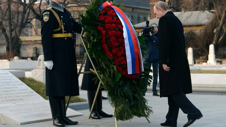 Russian President Vladimir Putin, right, laysa  wreath at the Soviet War Memorial in the Fiume Street National Graveyard in Budapest, Hungary, Tuesday, Febr. 17, 2015. Putin is staying on a one-day working visit in the Hungarian capital. (AP Photo/MTI, Tamas Kovacs)