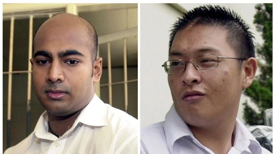 FILE - This combination of two file photos from Jan. 24, 2006, left, and Jan. 26, 2006 shows Australian drug traffickers Myuran Sukumaran, left, and Andrew Chan during their trial in Bali, Indonesia. Indonesia said on Monday, Feb. 16, 2015 it postponed the transfer of eight convicted drug smugglers, including seven foreigners, to a prison island for execution due to technical problems. The eight are facing execution despite international appeals for clemency. Among them are Chan and Sukumaran, the ringleaders of a group of nine Australians arrested in 2005 for attempting to smuggle heroin to Australia from the Indonesian resort island of Bali. (AP Photo/Firdia Lisnawati, File)
