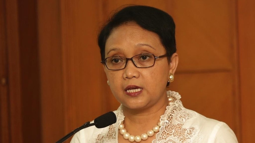 Indonesian Foreign Minister Retno Marsudi speaks during a press conference on President Joko Widodo's decision to reject clemency requests by foreign drug convicts, in Jakarta, Tuesday, Feb. 17, 2015. Indonesia postponed the transfer of eight convicted drug smugglers, including seven foreigners, to a prison island for execution due to technical problems and to allow the two Australians, Andrew Chan and Myuran Sukumaran, among them to spend more time with their families, an official said Tuesday. (AP Photo/Achmad Ibrahim)