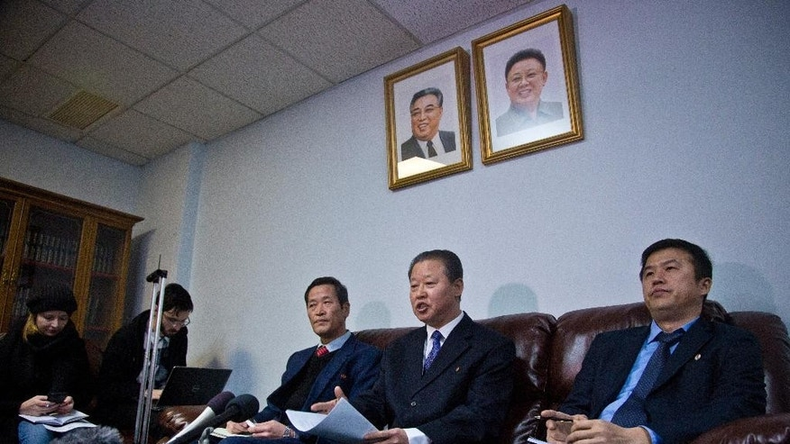 "North Korea's U.N. Ambassador Jang II Hun, center, is seated between North Korea's mission consulars Kin Song, left, and Kwon Jong Gun, right, as he speaks during a press conference, Monday, Feb. 16, 2015, at North Korea's  Mission in New York. North Korea says it will respond ""very strongly"" to a conference in Washington on Tuesday about its widespread human rights abuses. (AP Photo/Bebeto Matthews)"