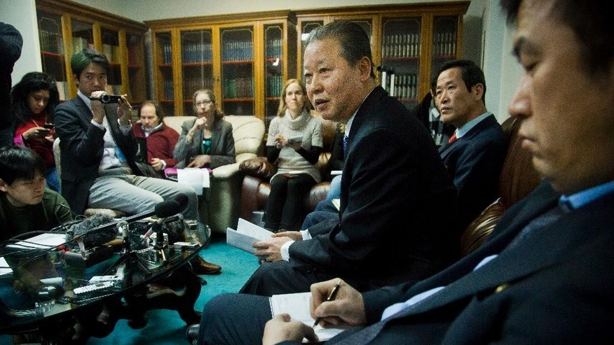"""North Korea's U.N. Ambassador Jang II Hun, third from right, is seated between North Korea's mission consulars Kin Song, second from right, and Kwon Jong Gun, far right, as he speaks during a press conference, Monday, Feb. 16, 2015, at North Korea's  Mission in New York. North Korea says it will respond """"very strongly"""" to a conference in Washington on Tuesday about its widespread human rights abuses. (AP Photo/Bebeto Matthews)"""