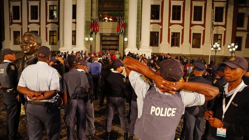 Feb. 12, 2015: South African Police provide security at the entrance to  Parliament after the session was disrupted during the official opening session in Cape Town, South Africa. (AP)
