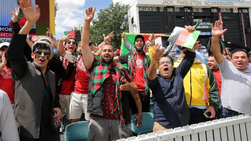 Supporters of the Afghanistan team cheer their team ahead of their Cricket World Cup Pool A match against Bangladesh in Canberra, Australia, Wednesday, Feb. 18, 2015. (AP Photo/Rob Griffith)