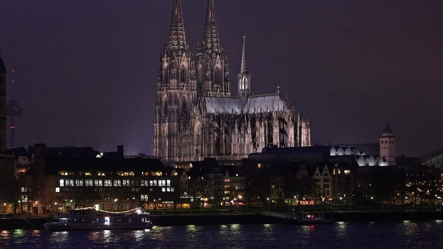 FILE - In this Jan. 5, 2015 file picture the famous Cologne cathedral is illuminated  in Cologne, Germany. The Roman Catholic archdiocese of Cologne has published accounts showing the full extent of its wealth for the first time.  Documents posted on its website Wednesday  Feb. 18, 2015 show Germany's richest archdiocese had assets of 3.35 billion euros (US $3.82 billion) at the end of 2013.    (AP Photo/Martin Meissner.file)