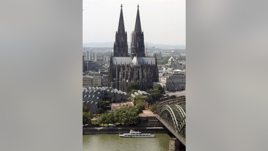 FILE - This July 31, 2008 file photo shows a view of the Cologne Cathedral in Cologne, Germany. The Roman Catholic archdiocese of Cologne has published accounts showing the full extent of its wealth for the first time. Documents posted on its website Wednesday Feb. 18, 2015  show Germany's richest archdiocese had assets of 3.35 billion euros ($3.82 billion) at the end of 2013.     (AP Photo/Roberto Pfeil, file)
