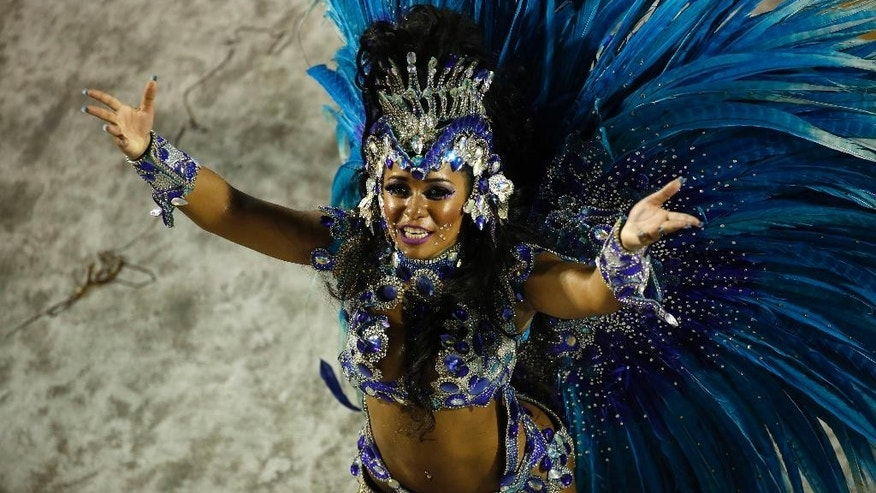 Drum Queen Raissa de Oliveira from the Beija Flor samba school, parades during Carnival celebrations at the Sambadrome in Rio de Janeiro, Brazil, Tuesday, Feb. 17, 2015. (AP Photo/Leo Correa)