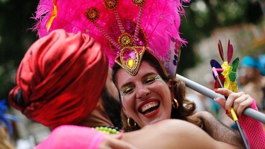 """Revelers dance during the """"Mulheres Rodadas"""" block carnival parade in Rio de Janeiro, Brazil, Wednesday, Feb. 18, 2015. As Carnival season winds down in Brazil, hundreds of women have gathered for a  street party to mock the social stigma tied to them being sexually experienced. """"Mulheres Rodadas"""" loosely translates as women who have been around. (AP Photo/Silvia Izquierdo)"""