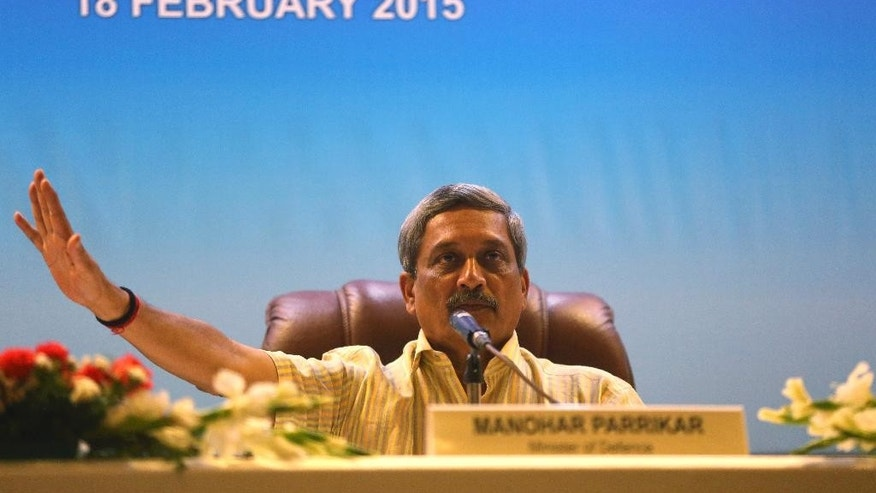 "Indian Defense Minister Manohar Parrikar gestures to a journalist during a press conference at the Aero India 2015 at Yelahanka air base in Bangalore, India, Wednesday, Feb. 18, 2015. Parrikar said he will investigate a senior officer's comment that an Indian coast guard vessel had destroyed a Pakistani ""terror boat"" late last year, contradicting the ministry's position that the men on board blew up their own boat. (AP Photo/Aijaz Rahi)"