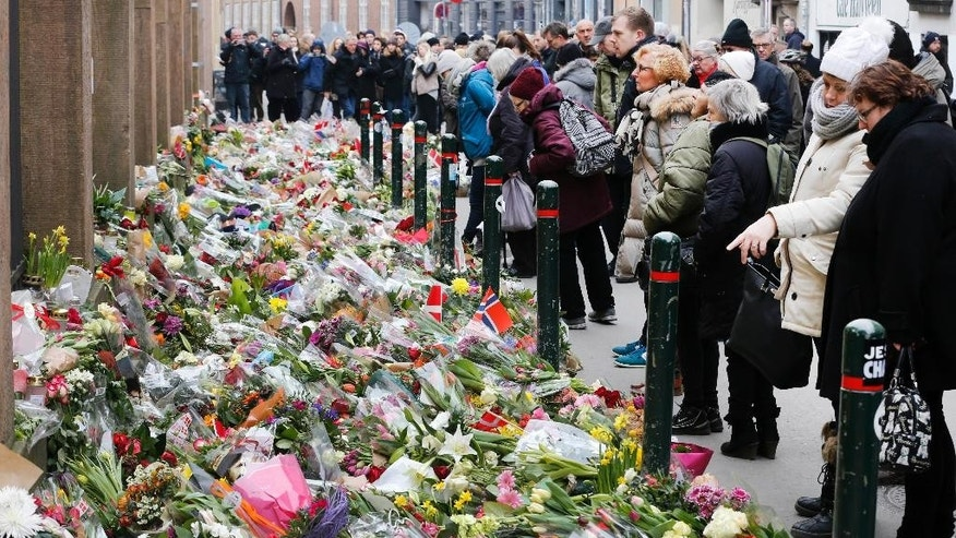 Flowers are laid in front of the synagogue in Copenhagen, Denmark, Tuesday, Feb. 17, 2015, following recent attacks. A Danish gunman who attacked a free-speech seminar and a synagogue was released about two weeks ago from a jail where he may have been radicalized while serving time for a vicious stabbing. As Denmark mourned the two victims, these and other troubling details emerged Monday about Omar Abdel Hamid El-Hussein's path to the country's worst terror spree in three decades.(AP Photo/Michael Probst)