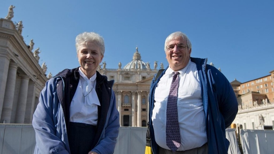 "Sister Jeannine Gramick, left, and Francis DeBernardo, Executive Director of Catholic gay rights group New Ways Ministry, pose for a photo in front of St. Peter's Basilica, at the Vatican, after attending Pope Francis' weekly general audience, Wednesday, Feb. 18, 2015. The Vatican did something it has never done before by giving a group of U.S. gay and lesbian Catholics VIP seats at Pope Francis' weekly general audience. But in a sign that the welcome wasn't all it could have been, the New Ways Ministry pilgrims were only identified on the Vatican's list of attendees as a ""group of lay people accompanied by a Sister of Loreto."" (AP Photo/Andrew Medichini)"