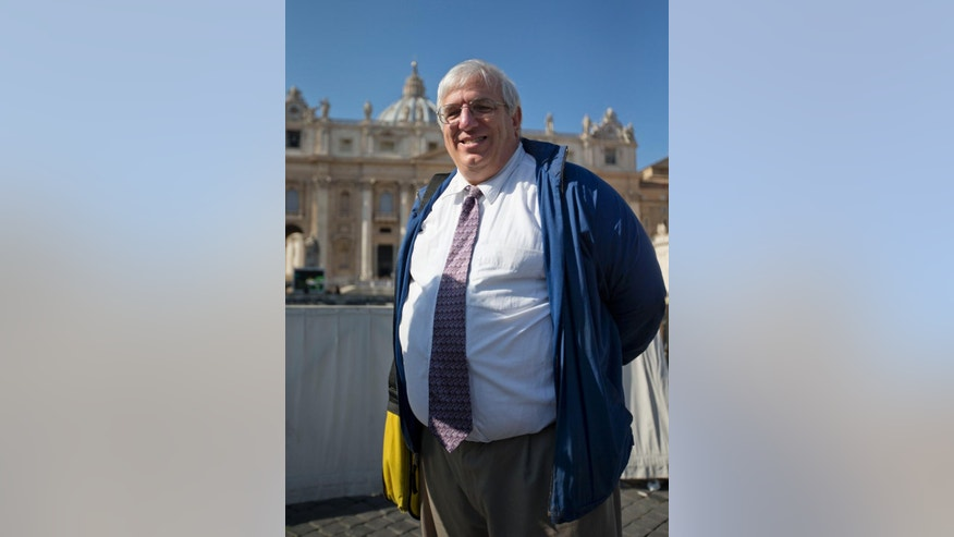 "Francis DeBernardo, Executive Director of Catholic gay rights group New Ways Ministry, poses for a photo in front of St. Peter's Basilica, at the Vatican, after attending Pope Francis' weekly general audience, Wednesday, Feb. 18, 2015. The Vatican did something it has never done before by giving a group of U.S. gay and lesbian Catholics VIP seats at Pope Francis' weekly general audience. But in a sign that the welcome wasn't all it could have been, the New Ways Ministry pilgrims were only identified on the Vatican's list of attendees as a ""group of lay people accompanied by a Sister of Loreto."" (AP Photo/Andrew Medichini)"