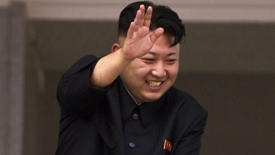 July 27, 2013: In this file photo, North Korean leader Kim Jong Un leans over a balcony and waves to Korean War veterans cheering below at the end of a mass military parade on Kim Il Sung Square in Pyongyang to mark the 60th anniversary of the Korean War armistice.